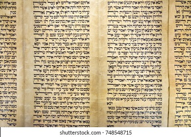 "JERUSALEM, ISRAEL - OCTOBER 13, 2017: A Sefer Torah or ""Torah scroll"" is a handwritten copy of the Torah, Torah is the ""Old Testament"" bible in hebrew language"