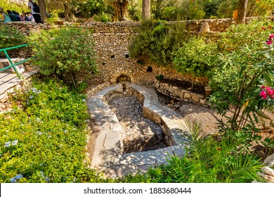 Jerusalem, Israel - October 14, 2017: Outdoor wine press in Garden Tomb park considered as place of burial and resurrection of Jesus Christ near Old City of Jerusalem
