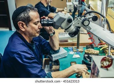 Jerusalem, Israel - October 18, 2015. Man works in Yvel Jewelry Factory in Jerusalem