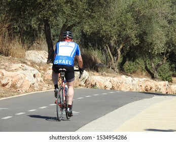 Jerusalem, Israel , October 18 , 2019. unknown cyclist pedaling in the  valley of the Cross , in Jerusalem