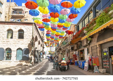 JERUSALEM, ISRAEL - OCTOBER 19, 2017: Yoel Moshe Salomon Street in Jerusalem in the historical district of Nachalat Shiva, decorated with brightly colored umbrellas