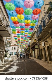 JERUSALEM, ISRAEL - OCTOBER 19, 2017: Yoel Moshe Salomon Street in Jerusalem in the historical district of Nachalat Shiva, decorated with brightly colored umbrellas. Israel