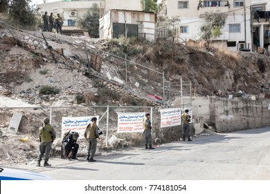 Jerusalem, Israel, October 29, 2010: Jewish soldiers watching an Palestinian, trebled residential district of Silwan in the centre of Jerusalem, meters south from Jerusalems Old Town.