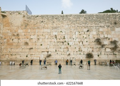 Jerusalem, Israel - Saturday, March 11, 2017 - Men standing in front of the western wall in Jerusalem