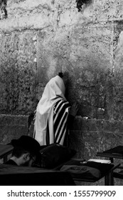 Jerusalem, Israel, Semptember 15th 2019 - Black and white picture of two jews praying at the western wall, the remaining holy stones of the Temple of Solomon.
