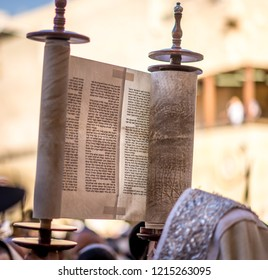 Jerusalem, Israel - Sep 26 2018: Lifting up the Torah scroll at the Western wall for Jewish holiday of Simchat Torah (Rejoicing with the Torah), following Sukkot (Feast of Tabernacles)