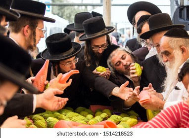JERUSALEM, ISRAEL - SEPTEMBER 20, 2018: The concept of photo tourism. Religious Jews are buying etrog - the fruit of  magnificent tree. The bazaar in Jerusalem on the eve of Sukkot