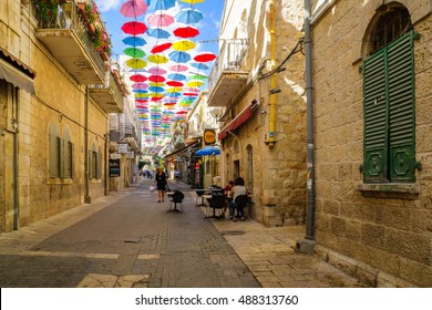 JERUSALEM, ISRAEL - SEPTEMBER 23, 2016: Scene of Yoel Moshe Solomon Street, decorated with colorful umbrellas, with locals and visitors, in the historic Nachalat Shiva district, Jerusalem, Israel