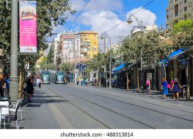 JERUSALEM, ISRAEL - SEPTEMBER 23, 2016: Scene of Yafo Street, with trams, locals and visitors, in Jerusalem, Israel