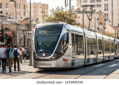 JERUSALEM, ISRAEL. September 27, 2018.  Passengers waiting for the light rail tram at the Jaffo Road in downtown Jerusalem, Red Line of the Jerusalem Light Rail concept image. Alstom Citadis 302.