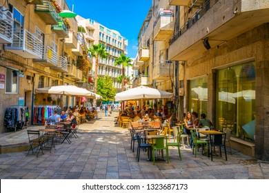 JERUSALEM, ISRAEL, SEPTEMBER 7, 2018: People are passing through the center of Jerusalem stretched alongside Jaffa street, Israel