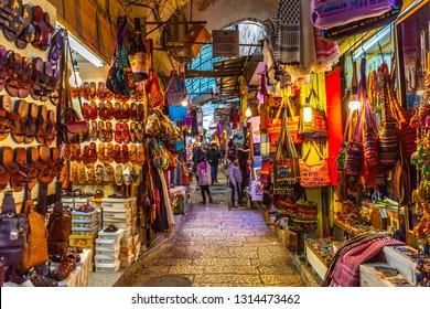 Jerusalem, Israel-01.07.2019:  Market in Old city, The Muslim Quarter. Narrow street with ancient Jerusalem architecture, Israel. Narrow street in old city part of Jerusalem with bazaar, Israel