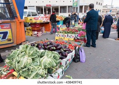 JERUSALEM, ISRAEL/PALESTINE - March 18, 2016 - Vegetable and fruit selling on the street outside the entrance of the old city of Jerusalem (near the Muslim Quarters)
