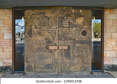 JERUSALEM - JANUARY 2017:  Copper covered doors of the Knesset building, Israel's parliament, with abstract designs representative of the ancient tribes of Israel.