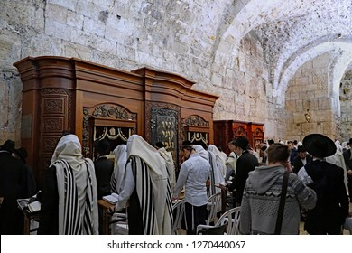 JERUSALEM - JANUARY 2017:  Jewish men wearing prayer shawls at the section of the Western Wall under Wilson's arch, in front of Torah arks, as seen in Jerusalem circa 2017.