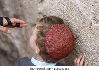 Jerusalem, Israel/February 5, 2018:The Jew boy prays near the Western Wall  in the Old City of