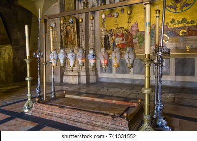 JERUSALEM - JULY 18, 2008: The Stone of Anointing in the Church of the Holy Sepulchre on July 18, 2008 in Jerusalem.