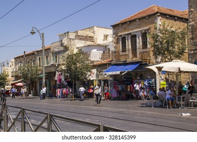 JERUSALEM - July 31,2015: People crossing the intersection of always busy streets of downtown Jerusalem during Friday preparation for the Evening of Shabbat.Jerusalem,July 31,2015