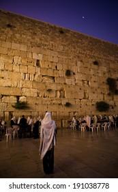 JERUSALEM - JUNE 26: Orthodox Jewish men pray at the famous wailing wall for Shabbas on June 261, 2011 in Jerusalem.