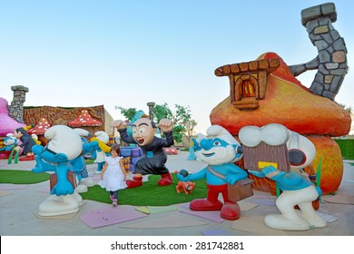 JERUSALEM - MAR 25 2015:Child (Talya Ben-Ari age 05) visit The Smurfs village in Cinema city.It's the largest entertainment and cultural center inJerusalem with team park, 19 theaters and indoor mall.
