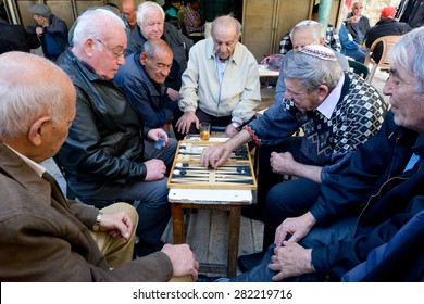 JERUSALEM - MAR 25 2015:Elderly men play backgammon in Mahane Yehuda Market in Jerusalem, Israel. Backgammon is among the oldest known board games, and many variants are played throughout the world.