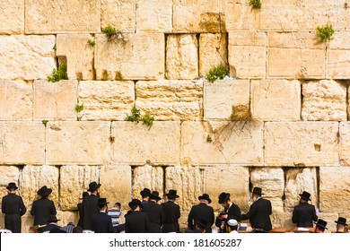JERUSALEM - MARCH 02: Jewish worshipers pray at the Wailing Wall. The most holy site for Jews. March 02, 2014 in Jerusalem, Israel.