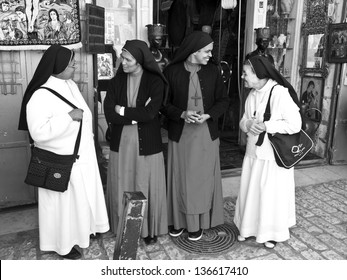 JERUSALEM - MARCH 29: Catholic nuns talking each other on the Via Dolorosa. March 29, 2013 in Jerusalem, Israel.