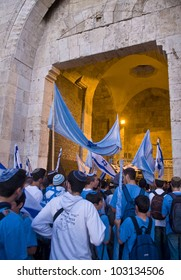 JERUSALEM - MAY 20 : Israeli men celebrate on Jerusalem day in front of Damascus gate in east Jerusalem on May 20 2012 , Jerusalem day marks the anniversary of the city's reunification in 1967