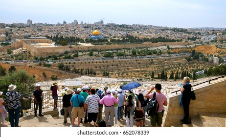 Jerusalem - May 24, 2017: The guide shows the Jerusalem Old City view to the tourists. Mount of Olives is a famous and sacred Christian's place and it has a fantastic view to the Old Jerusalem.