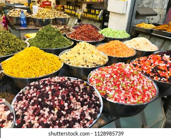 JERUSALEM - MAY 9, 2018: Mahane Yehuda Market Spice Vendor. Popular with locals and tourists, the market has more than 250 vendors selling fresh fruit, vegetables, baked goods, fish, meat and more.