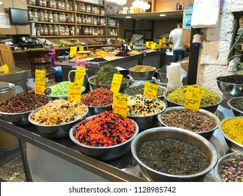 JERUSALEM - MAY 9, 2018: Mahane Yehuda Market Vendor. Popular with locals and tourists, the market has more than 250 vendors selling fresh fruit, vegetables, baked goods, fish, meat and more.