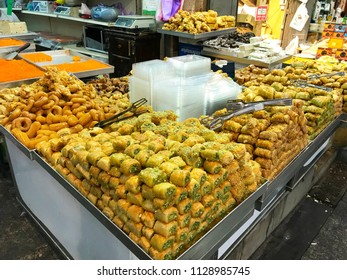 JERUSALEM - MAY 9, 2018: Mahane Yehuda Market Baklava vendor. Popular with locals and tourists alike, the market features more than 250 vendors.