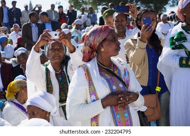 JERUSALEM - NOV 20, 2014: Ethiopian Jewish women mix old tradition of prays, with modern documentation devices, at the Sigd, in Jerusalem, Israel. The Sigd is an annual holiday of the Ethiopian Jews
