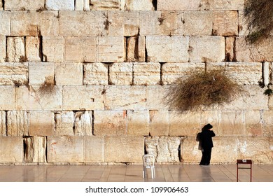 JERUSALEM - NOVEMBER 12:Jewish man is praying at the western wall on November 12 2008 in Jerusalem, Israel.It is the most sacred site recognized by the Judaism outside of the Temple Mount itself.