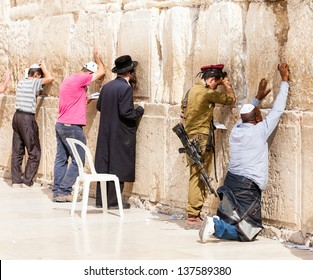 JERUSALEM - NOVEMBER 6: Jewish men pray at the Western Wall. The Western Wall a.k.a. the Wailing Wall is an important Jewish religious site in the Old City of Jerusalem, Israel, November 6, 2012
