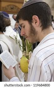 JERUSALEM -OCT. 02: Jews in prayer at the Western Wall during Jewish holiday of Sukkot October 02, 2012 in Jerusalem, Israel.