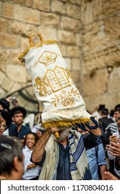 JERUSALEM - Oct 19 2016: Jewish man dancing with Torah scroll for Simchat Torah holiday, Western Wall