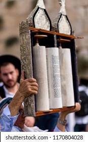 JERUSALEM - Oct 19 2016: Jewish man dancing with Torah scroll for Simchat Torah holiday, Western Wall