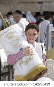 JERUSALEM, Oct. 2: Unknown boy at the Western Wall holding a Torah during the Jewish holiday of Sukkot, October 2, 2012 in Jerusalem, Israel