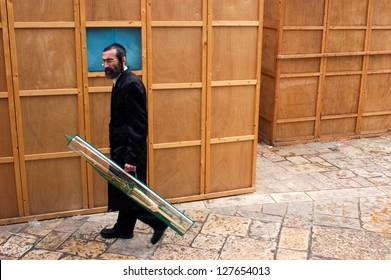 JERUSALEM - OCT 20:Orthodox Jewish man carry the four species during Sukkot Jewish holiday in Mea Shearim on October 20 2005 Jerusalem, Israel.