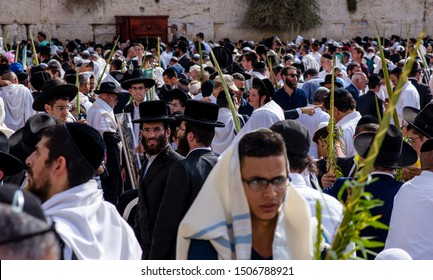 Jerusalem - Oct 26 2016: Jewish men gather at the Western Wall or the Kotel during the Feast of Sukkot