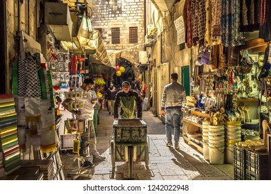 Jerusalem - Oct 26th 2018 - Locals getting ready for a work day inside the narrow streets of the Arab block in Jerusalem