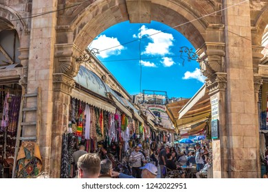 Jerusalem - Oct 26th 2018 - Locals and tourists walking around the narrow streets of the Arab block in Jerusalem