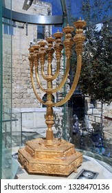 JERUSALEM - OCTOBER 2011:  A detailed reproduction of the menorah from the ancient Temple is on display in a glass case overlooking the Temple Mount.
