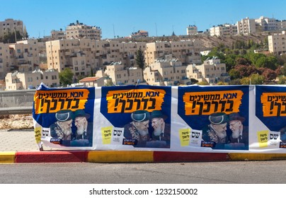 """JERUSALEM - OCTOBER 30: Roadside election campaign fliers for religious party """"Shas"""" and mayoral candidate Moshe Leon reads """"Father, we pursue Your way"""" on mayor elections day October 30, 2018"""