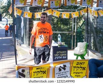 """JERUSALEM - OCTOBER 30: Unidentified campaigner for Zeev Elkin at his stand on mayor election day Nov 30, 2018 (""""Elkin to the Mayor"""", """"Jerusalem is stronger with Elkin"""", """"Jerusalem in good hands"""")"""