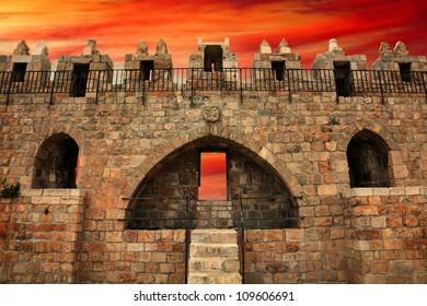 Jerusalem Old City - Damascus Gate (inside view) on the sunset background