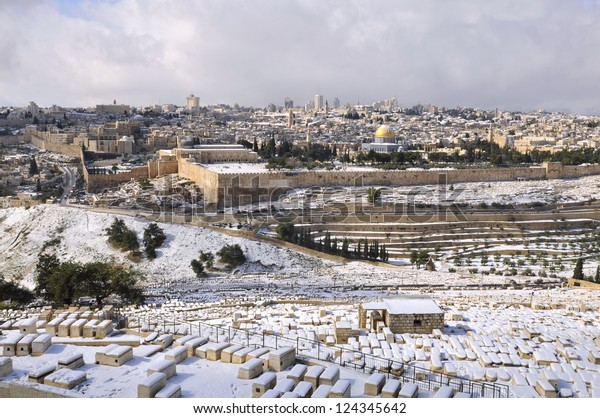 Jerusalem Old City under snow, view from the Mountain of Olives and Old Jewish cemetery