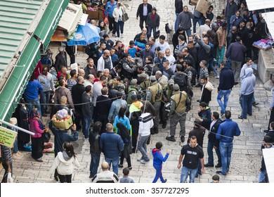 JERUSALEM OLD TOWN, ISRAEL - NOVEMBER 1, 2014: Unidentified Israeli soldiers apprehend a man near Damascus gate.
