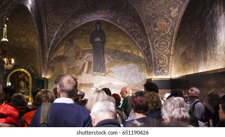 JERUSALEM OLD TOWN, ISRAEL - OCTOBER 31, 2014: Unidentified people in Calvary (Golgotha). Church of the Holy Sepulchre.